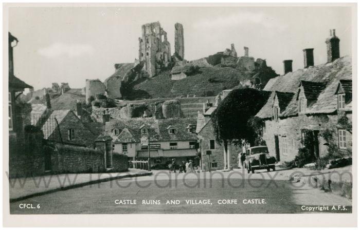 Postcard front: Castle Ruins and Village, Corfe Castle.
