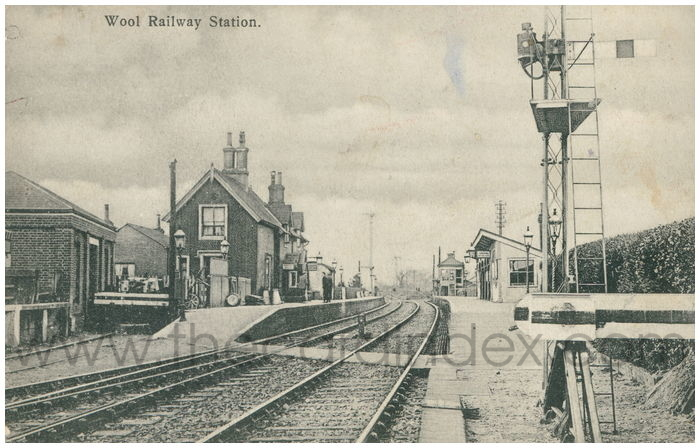 Postcard front: Wool Railway Station.