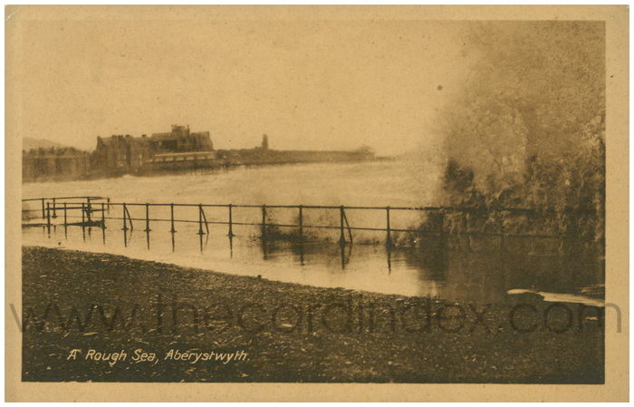 Postcard front: A Rough Sea, Aberystwyth.