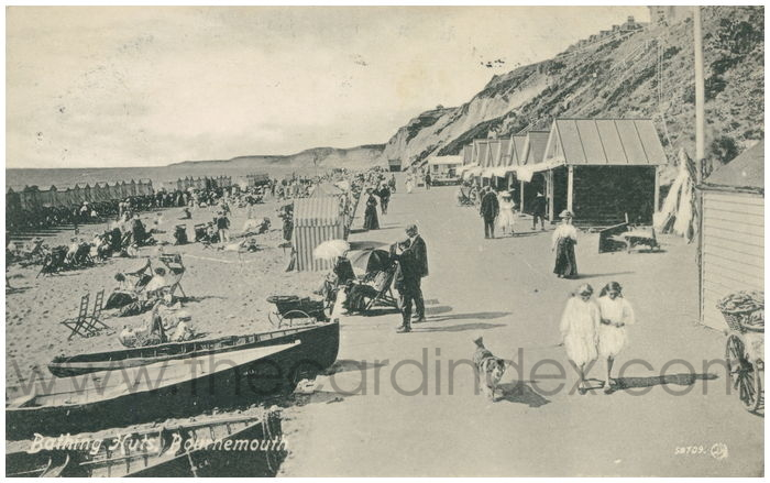 Postcard front: Bathing Huts, Bournemouth.