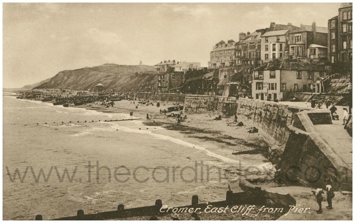 Postcard front: Cromer, East Cliff from Pier.