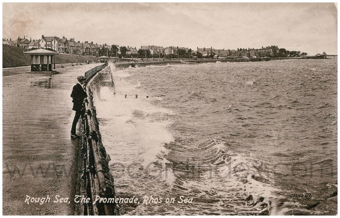 Postcard front: Rough Sea, The Promenade, Rhos on Sea