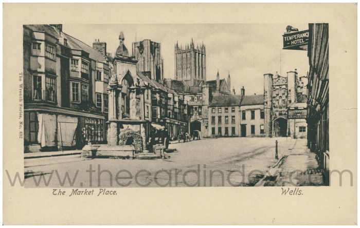 Postcard front: The Market Place. Wells.