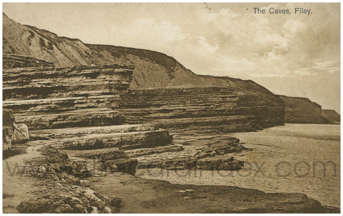 Postcard front: The Caves, Filey.