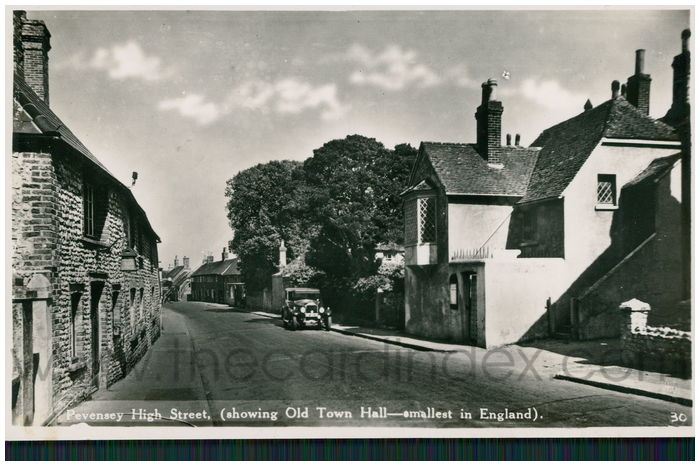 Postcard front: Pevensey High Street, (Showing Old Town Hall - Smallest in England)