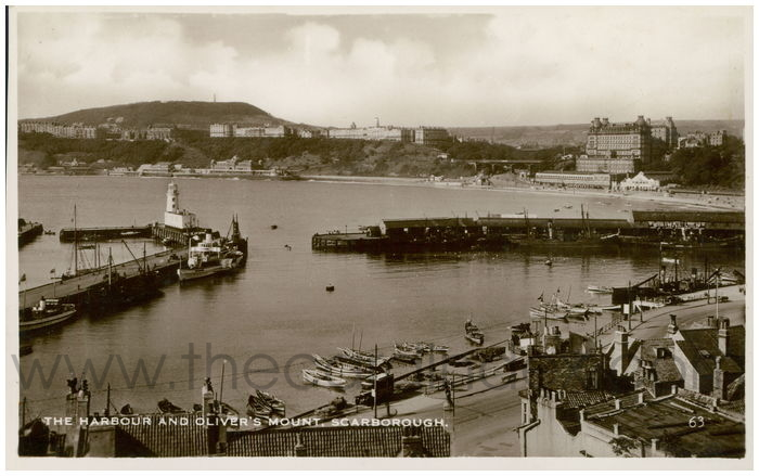 Postcard front: The Harbour and Oliver's Mount, Scarborough.