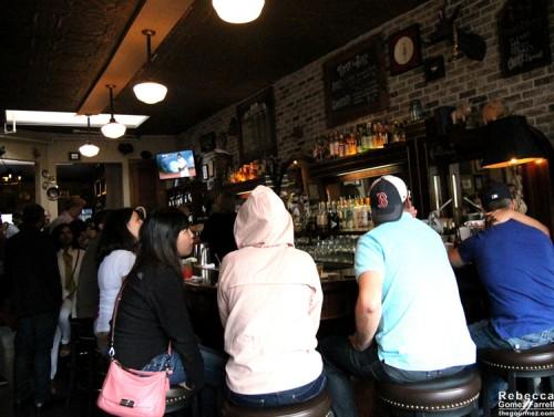 The crowd around the bar.