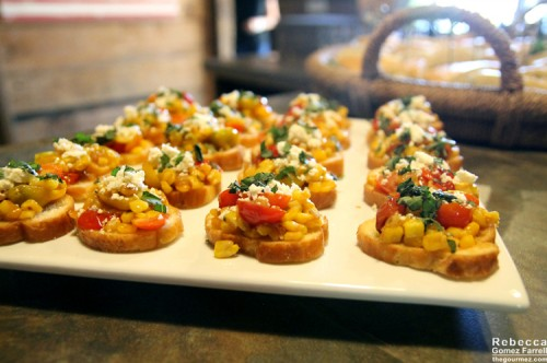 Blistered cherry tomatoes with caramelized corn and goat cheese.