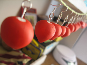 Hanging earrings to dry.