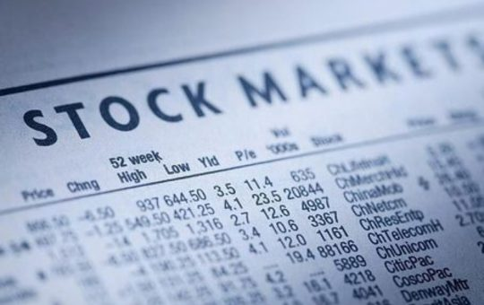 Stock markets listings newspaper 454x304
