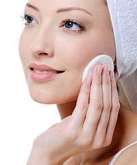 Woman applying skin toner