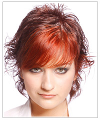 Woman with short wavy brown and red hair