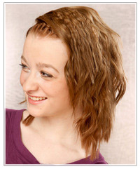 Model with plaited bangs