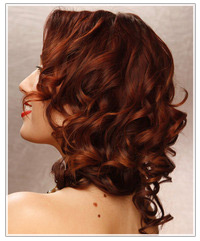Model with dark curly red hair