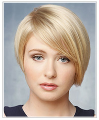 Model with short blonde hair and swept bangs