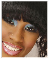 Model with brown hair and blue eye shadow