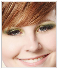 Model with brown hair and green eye shadow