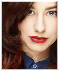 Model with red lipstick and brunette hair
