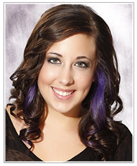 Model with brunette hair and purple highlights