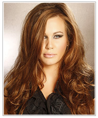 Model with longe curly copper hairstyle