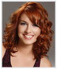 Model with long copper layered curls