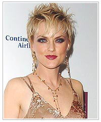 Elaine Hendrix with short, spiked hair
