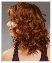 Model with glossy red curls