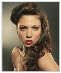 Model with half up half down curly hairstyle