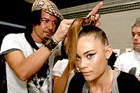 Brad Ngata styling a models hair