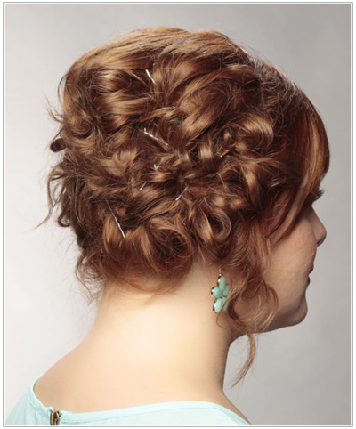 Model with a red curly updo