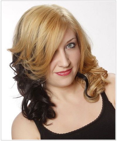 Model with blonde and black dip dye hair