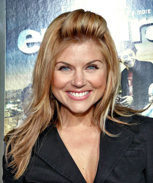 Tiffani Thiessen brings new life to the trendy hairstyle of the ponytail.