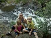 Cindy Adamski's daughter Angie and her kids Holly and Bo posing on large rock formation at  12 Foot Falls in Amberg. (Photo by Cindy Adamski)