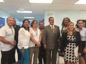 Latino leaders with Cash: L to R, Dr. Caban, E. Martinez, F. Friot, L.Velez, C. Rodriguez, Dr. Cash, SUNY Trustee Llewyn,