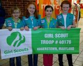 Junior Girl Scouts~ Jessica, Cameryn, Jillian and Lauren display their troop banner.