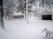 Heavy snow covering the ground by a home located west of Crivitz.