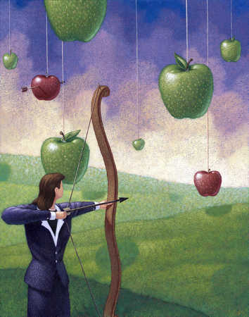 Businesswoman aiming bow and arrow at apple