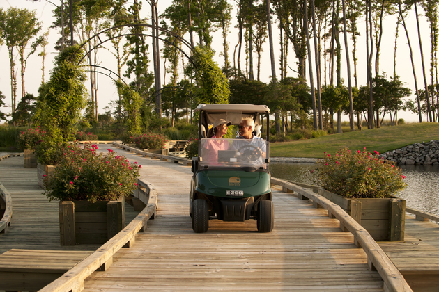 Couple on golf cart copy