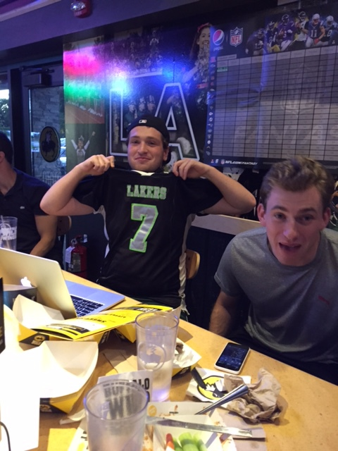 GMs Josh Birnberg and Mitch Jones pose at Buffalo Wild Wings following a successful draft