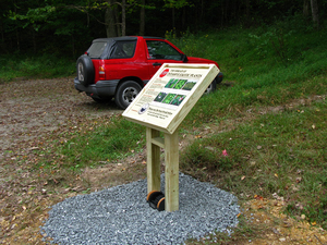 Boot brush interpretive sign installed by SACWMP on the Appalachian Trail in Hot Springs, NC.