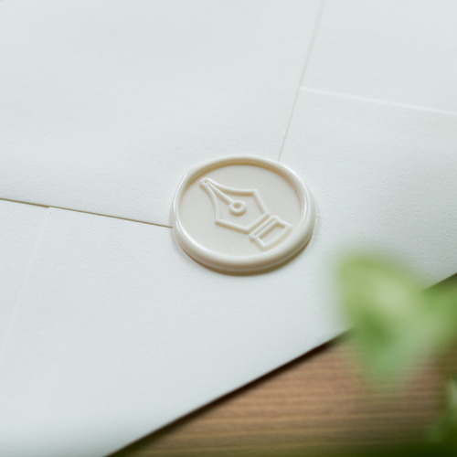 White Wax Seal on Desk
