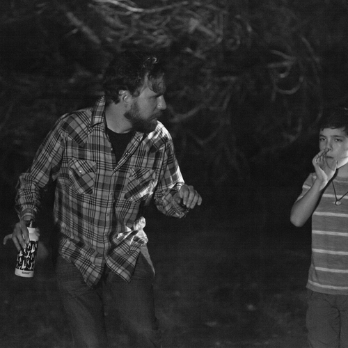 In a late night forest shoot  director micah barber coaches bryce gheisar %28thomas%29 on his owl sounds   photo by lisseth lopez