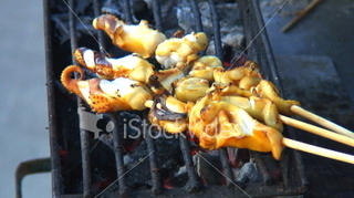 Ist2_2781083_hd1080_food_preparation_octopus_calamari_squid_skewers_on_charcoal_grill_medium