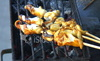 Ist2_2781083_hd1080_food_preparation_octopus_calamari_squid_skewers_on_charcoal_grill_thumb