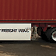 Trailer with aerodynamic skirting