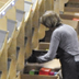 Worker pulling packages off DSW's sortation system