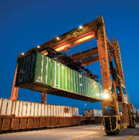Transferring an intermodal shipping container to rail