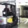 Forklift unloading pallets on loading dock