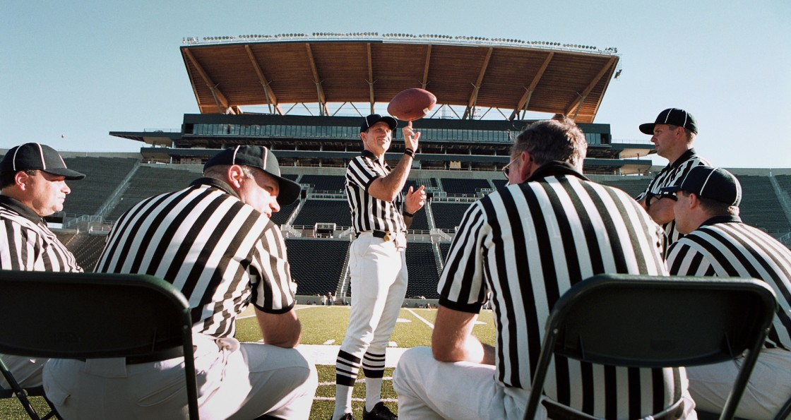 Referees take a time-out during halftime of a University of Oregon football scrimmage held at Autzen Stadium.
