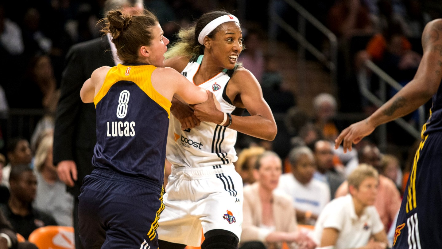 Candice Wiggins struggles to get open against Maggie Lucas #8 of the Indiana Fever during Game 1 of the Eastern Conference Finals.